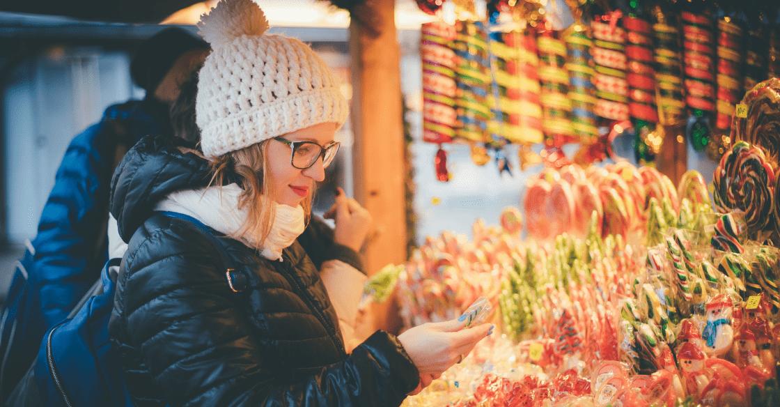 Buying treats at a holiday market