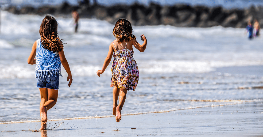 Kids playing on a San Diego beach