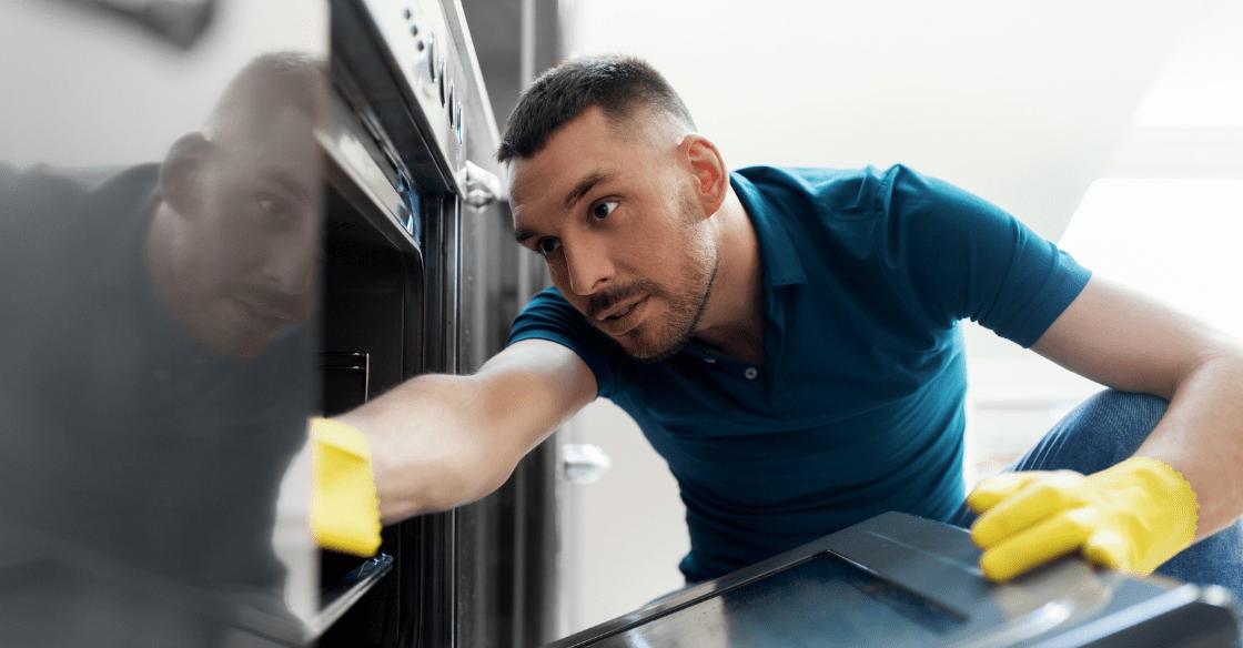 Man scrubbing his oven