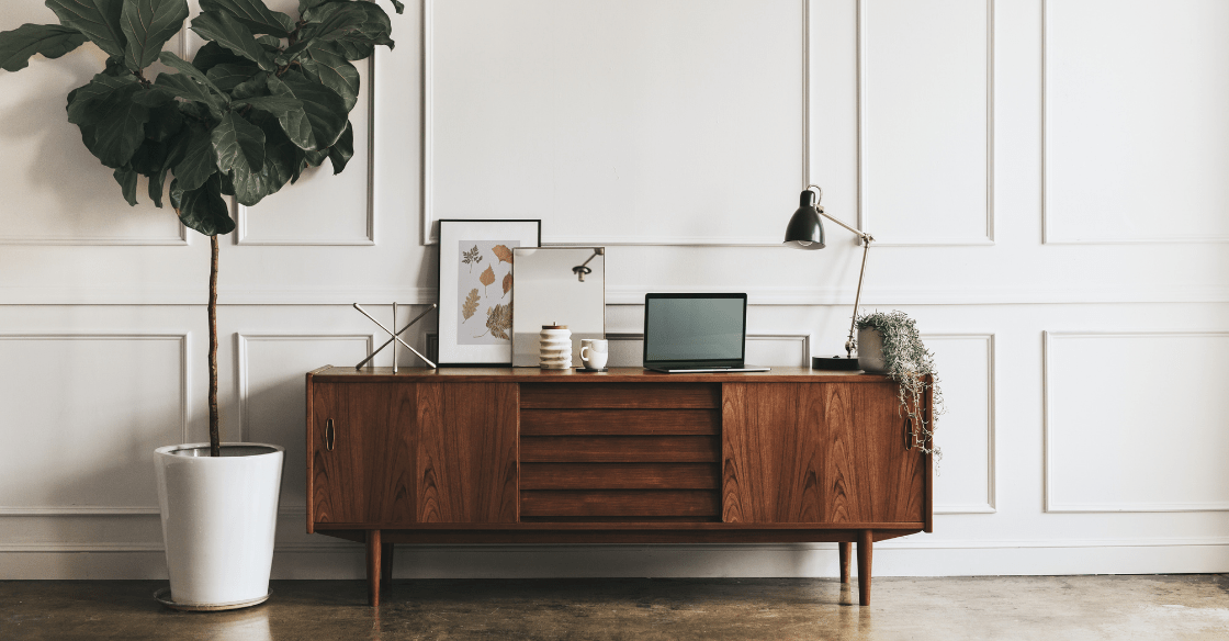 Credenza with an assortment of personal items